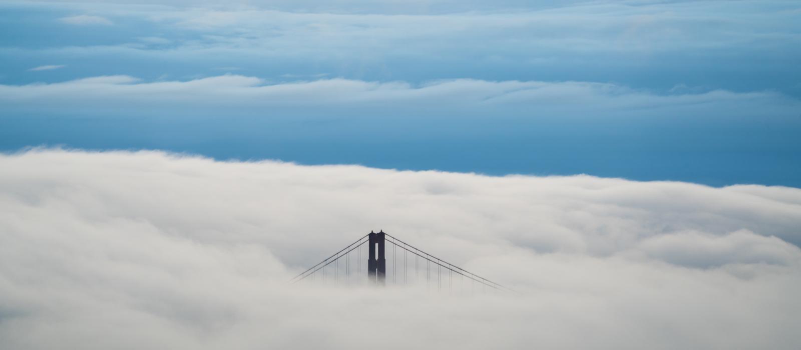 Cloud with bridge peaking above